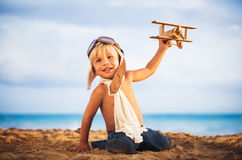 Super Hero kid with a mask flying Royalty Free Stock Photo