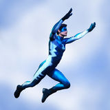 Super hero male side view Stock Photos