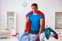 The super hero man husband ironing at home Stock Photos