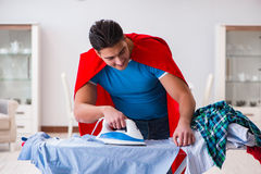 The super hero man husband ironing at home Stock Images