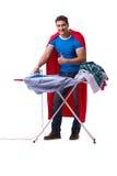 The super hero man husband ironing isolated on white Royalty Free Stock Photography