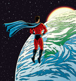 Super hero over Earth Stock Image