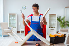 The super hero repairman working at home Royalty Free Stock Photography