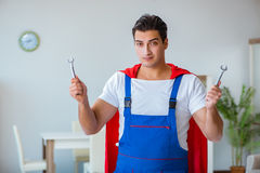 The super hero repairman working at home Royalty Free Stock Photos