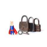 Super hero and retro style padlock collection on white background. Wooden clothespin peg character safety concept. Macro Stock Photography