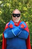 Super hero. Serious senior super heros with black mask having crossed arms stock photo