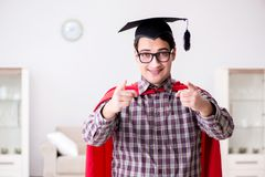 The super hero student wearing mortarboard in a red cloak Royalty Free Stock Image