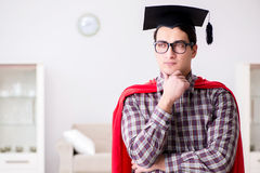 The super hero student wearing mortarboard in a red cloak Royalty Free Stock Photos