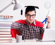 The super hero student wearing a mortarboard studying