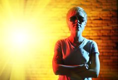 Super-hero woman portrait. Super-hero woman with burst of light royalty free stock images
