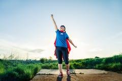 Super hero woman. Standing outdoors Stock Photo
