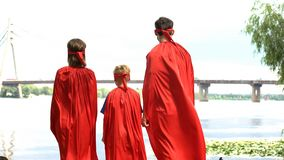 Super heroes looking at bridge, costume party, entertainment for whole family stock photos