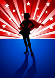 Super heroine. Silhouette illustration of a super heroine standing in front of light burst Stock Photos