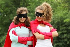 Super heros team. Super team of super heros girl with red cape and red gloves Stock Images