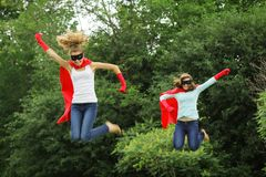 Super heros team jumping Royalty Free Stock Photo