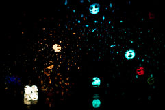 Super High resolution Abstract glowing rain drops blurred background in dark Royalty Free Stock Image