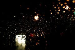 Super High resolution Abstract glowing rain drops blurred background in dark Stock Images