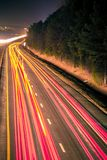 Super highway with high volume of cars at night royalty free stock images