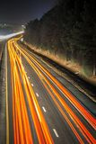 Super highway with high volume of cars at night royalty free stock photos