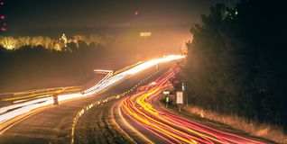 Super highway with high volume of cars at night royalty free stock photo