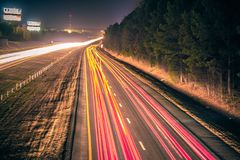 Super highway with high volume of cars at night stock images