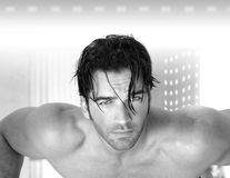 Sexy male model. Super hot sexy muscular male model against modern background Royalty Free Stock Photos