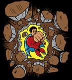 Super héroe que perfora a través de la pared Fotos de archivo