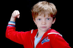 Super Kid!. Cute kid in a muscleman pose Royalty Free Stock Photos