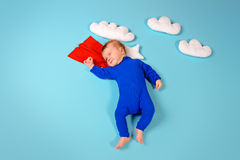 Super kid. Newborn baby. Little super hero flying through the sky Stock Photography
