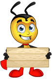 Super Little Bee - Holding Wooden Sign. A cartoon illustration of a cute looking Superhero Little Bee Character stock illustration