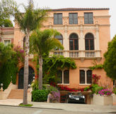 Super luxury Villa. In San Francisco Pacific Heights. Car emerging  from the underground garage, palm trees, stucco balcony, giant windows, and a spectacular Stock Images