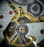 Super macro clock mechanism 2. Super macro part of clock mechanism, old watch with gems Stock Photo