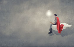 Super man with book Royalty Free Stock Images