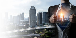 Super man on city guardiance. Businessman opening his shirt on chest acting like super hero Royalty Free Stock Photo