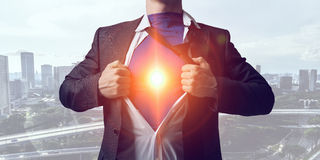 Super man on city guardiance. Businessman opening his shirt on chest acting like super hero Royalty Free Stock Photos