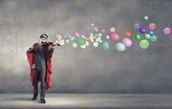 Super man with violin Stock Photography