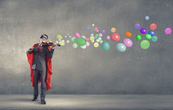 Super man with violin Stock Image