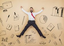 Super manager. Happy manager jumping high in a victorious pose. Studio shot on a beige background Royalty Free Stock Photography