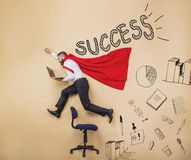 Super manager. Manager wearing cloak of superman. Studio shot on a beige background Royalty Free Stock Photography