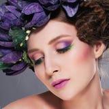 Super model brunette in wreath of flowers Stock Photos