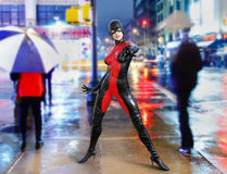 Super model superhero Manhattan street. Female super model superhero on a wet street in Manhattan, New York city Royalty Free Stock Image