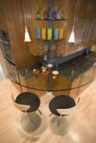 Super Modern Contemporary Bar. Custom bar built right into the kitchen for hanging out or entertaining Stock Image