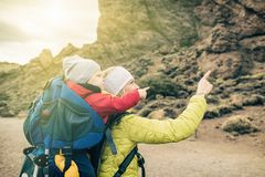 Super Mom with baby boy hiking in backpack Stock Image