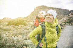 Super Mom with baby boy hiking in backpack Royalty Free Stock Photography
