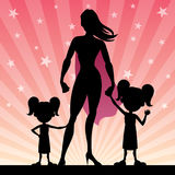 Super Mom 2 Daughters. Super mom with her 2 little daughters Royalty Free Stock Photography