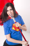 Super Mom Singing Karaoke with Broom Stick Royalty Free Stock Photo