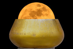 Super moon in alms bowl. Super moon yellow in alms bowl on a black background stock photos