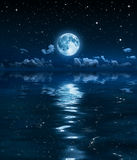 Super moon and clouds in the night on sea Stock Photo
