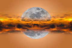 Super moon between clouds at the nighttime. Nature background. Stock Image