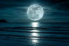 Super moon. Colorful sky with cloud and bright full moon over se Royalty Free Stock Images